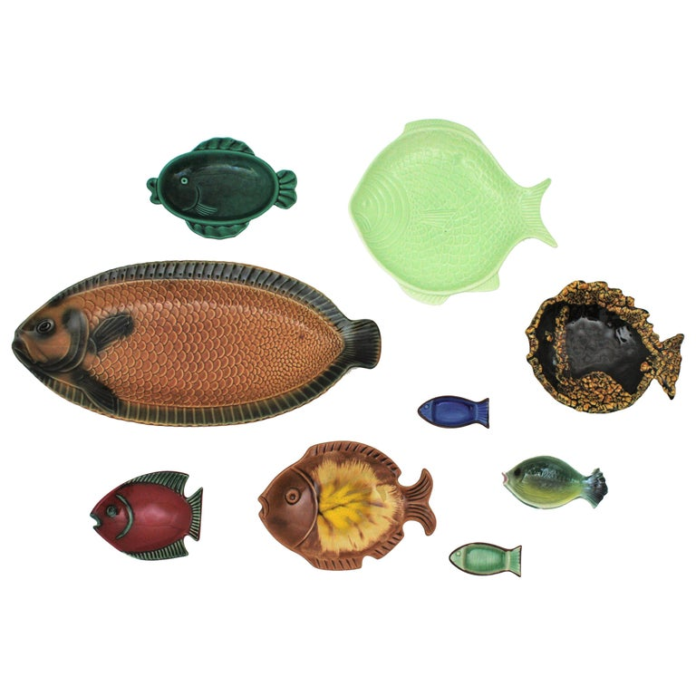 Mid-Century Modern European Majolica glazed ceramic fishes wall decoration. 1950s-1960s The set is comprised by 9 pieces: fish platters, plates and fish wall sculptures from Italy, France, Spain, Austria and Portugal. The set is colorful with