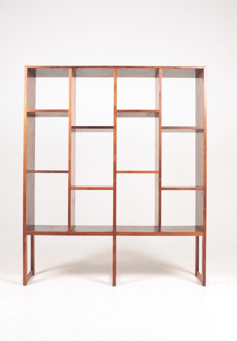 Freestanding bookcase in rosewood designed and made in Denmark. Great original condition.