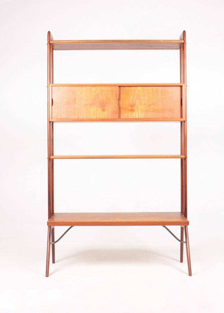 Bookcase in teak designed by Kurt Østervig M.A.A. for K.P furniture in 1960s. Made in Denmark, great condition.