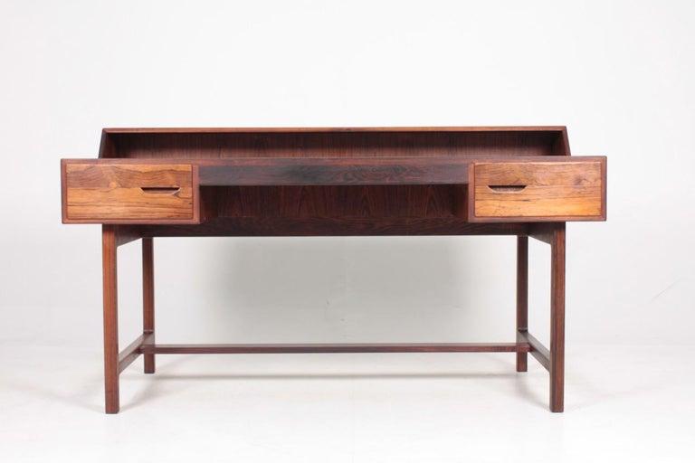 Great looking freestanding desk in rosewood and black leather, designed by Kurt Østervig for K.P. Møbler, Denmark. Great original condition.