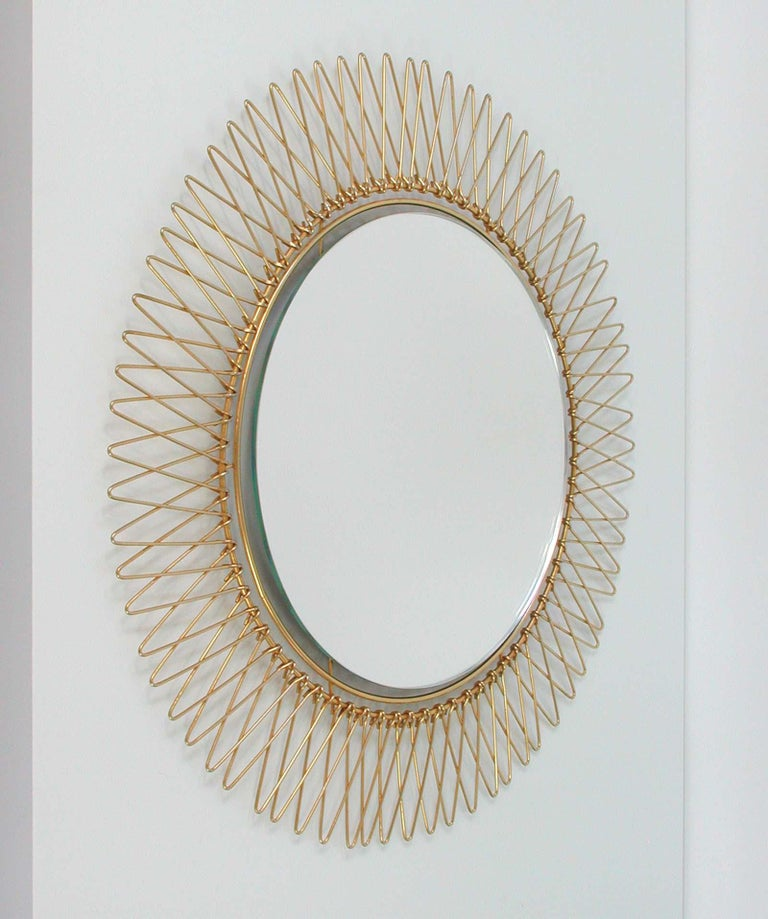 This round brass sunburst mirror was made in France in the 1950s.  Diameter of mirror only (without frame) is 11.5
