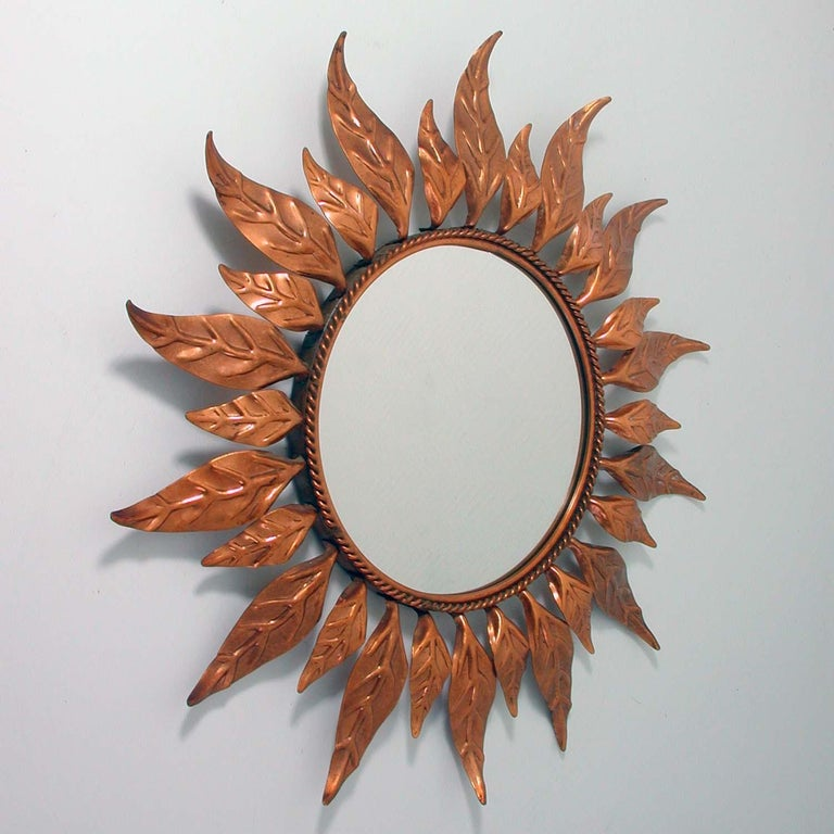 This round copper sunburst mirror was made in France in the 1950s.  Diameter of mirror only is 8.7