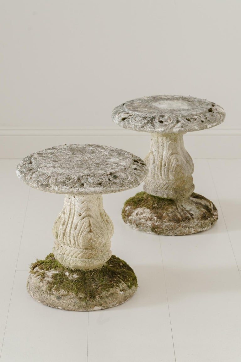 A charming pair of French cement garden stools with beautiful lichen on each base, circa 1950.