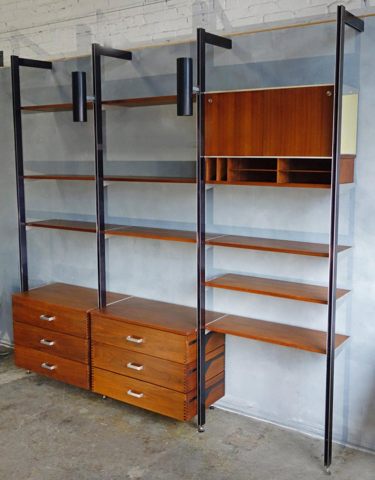 For your consideration is this authentic and original CSS Unit designed by George Nelson for Herman Miller.  A three bay wall unit including the scarce dovetailed drawers.  Also including  9x 12'' shelves 2x 18.5