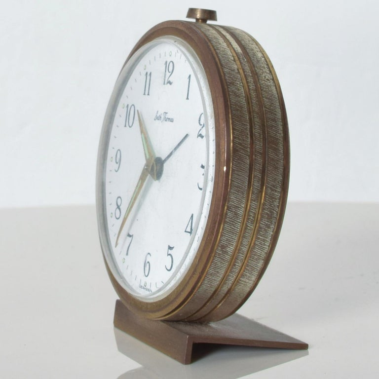 Seth Thomas German miniature brass alarm wind up clock elegant midcentury 1950s made in Germany.  Dimensions: approximately 3.38