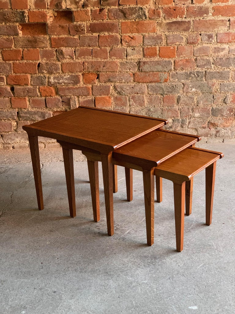 Gordon Russel golden oak nest of tables midcentury, circa 1950  Gordon Russell, mid-20th century light oak nest of three tables, circa 1950, with raised crossgrain borders and tapering rectangular legs, Provenance: purchased by the vendor's family