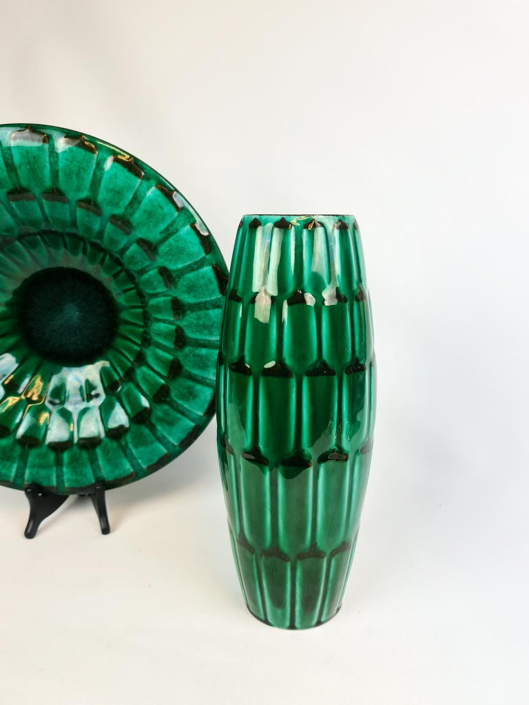 A wonderful vase and platter produced by Upsala Ekeby Sweden designed by Anna-Lisa Thomson 1951. Wonderful green glace with pattern of artichoke.   Very good condition. Small traces of wear on the bottom  Measures: Vase H 30 cm, D 17 cm, platter