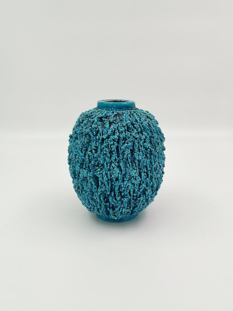 A blue Chamotte vase by Swedish designer Gunnar Nylund. Produced at Rörstrand and fully marked. Very good vintage condition with some minor chips that don't effect the overall impression.