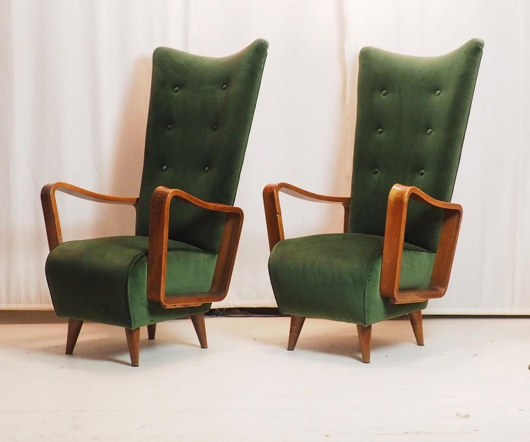 Splendid pair of armchairs designed by the Italian architect Pietro Lingeri, with high back and pronounced wooden armrests. Covered with a green oak velvet, pure Italian cotton. Elegant and stylish.  Perfectly upholdtered with wonderful green Velvet