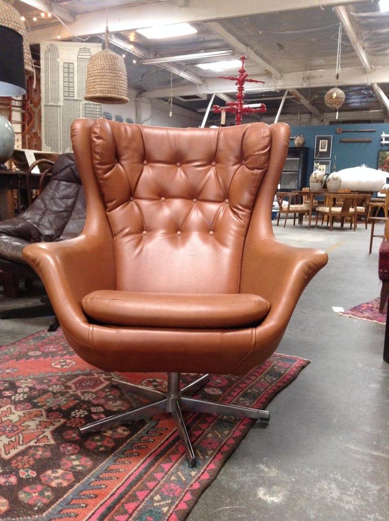 Beautiful midcentury HW Klein chair in light brown. This piece is comfortable and Classic, fits great in almost any space.
