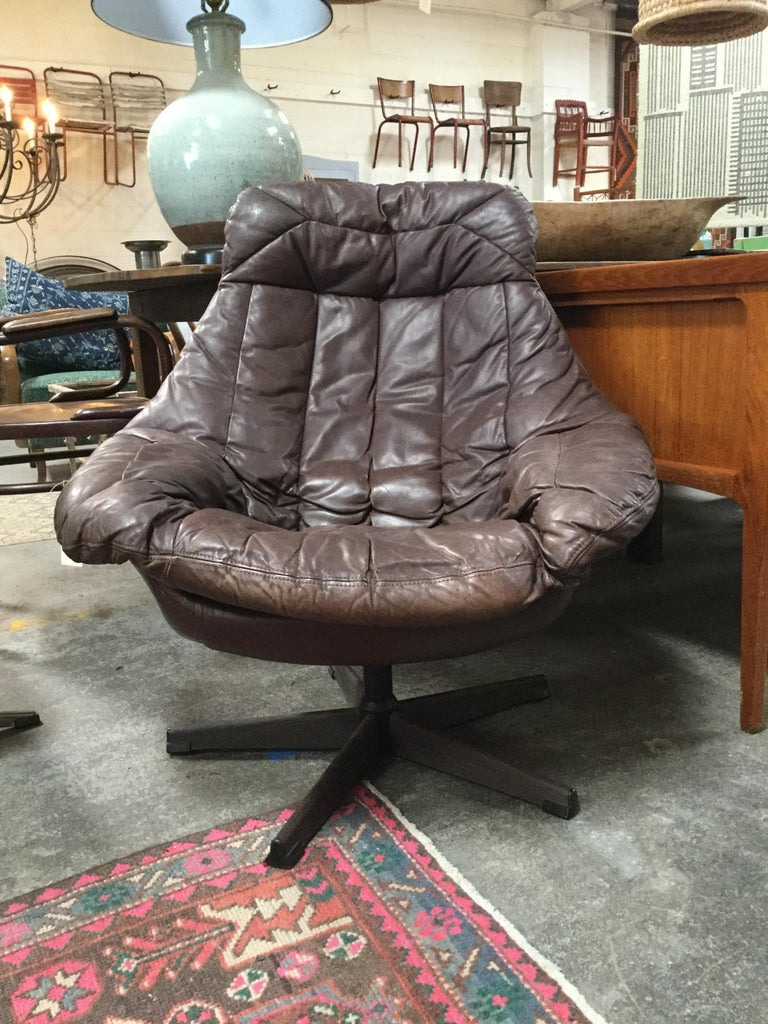 Vintage HW Klein dark brown leather lounge chair in great condition. Classic midcentury design that's a cool (and comfy) statement in any space.
