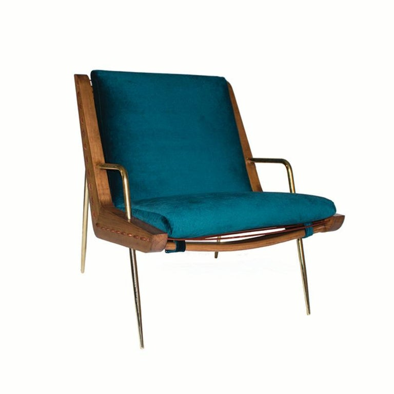 The handcrafted midcentury inspired lounge chair and ottoman are a unique creation by Leon Leon Design from Mexico City. It features a solid maple wood frame, handwoven with a 5 mm natural leather cordon and solid brass legs. It comes with an