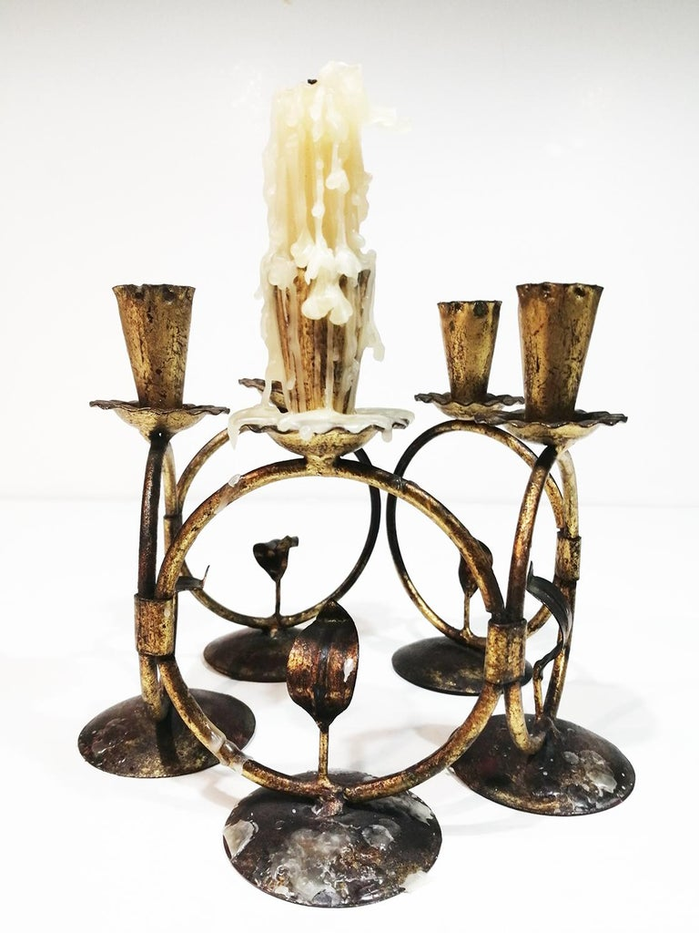 Midcentury iron golden candleholder transformable   With its five circles, it can be transformed in different ways to adapt to space, such as a circular or elongated table as a centerpiece or on a sideboard.