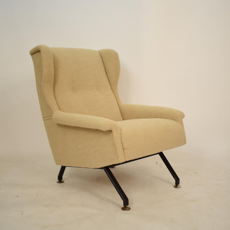 This beautiful midcentury Italian armchair or lounge chair was recently reupholstered in sandy or beige sheep wool fabric. It was made in the 1950s in Italy.