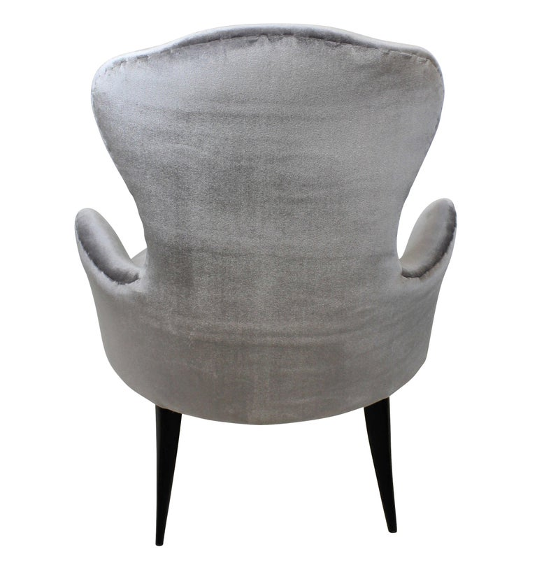 A pair of Italian bedroom chairs of elegant proportions, with cabriole legs and newly upholstered in silver velvet.