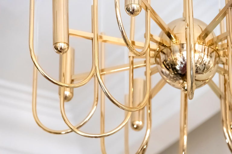 Italian midcentury chandelier is made of polished brass and clear glass in the holders. This chandelier includes 8 pieces. E14 bulbs. Its is in a very good original vintage condition.