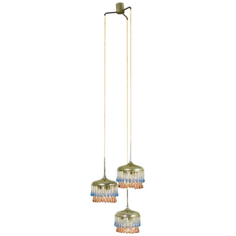 Midcentury Italian Chrome and Glass Nine-Light Pendant Lamp by Stilnovo For Sale
