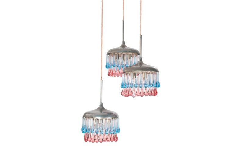 A rare and elegant pendant lamp produced by Stilnovo in the 1950s. It consists in 3 hanging shades with a Murano pendant decoration. Each shade shows three-light bulbs. Height at will and Stilnovo yellow label (early production) as showed in