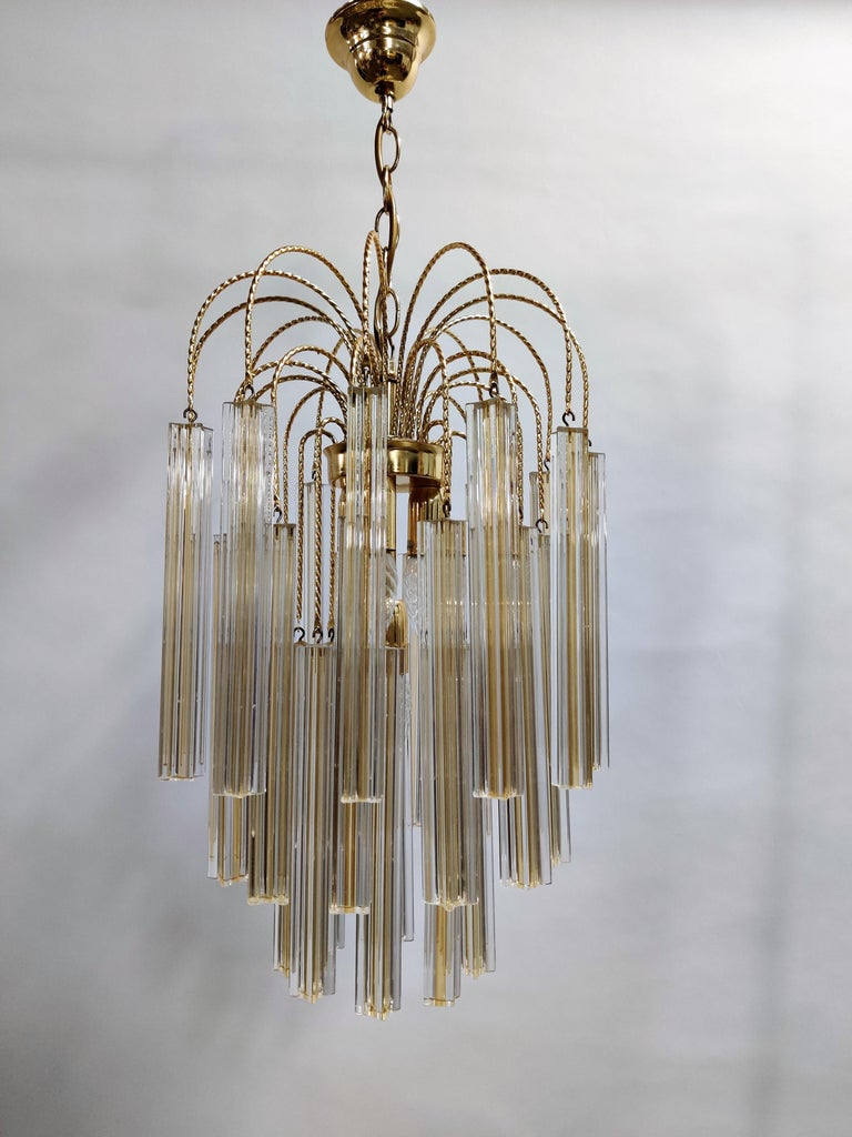 Very beautiful brass chandelier with handmade Murano Venini crystal glass.  The chandelier has multiple lightpoints, creating a beautiful warm light.  Perfect condition, no damages to the glass.  The chandelier has been tested and works with