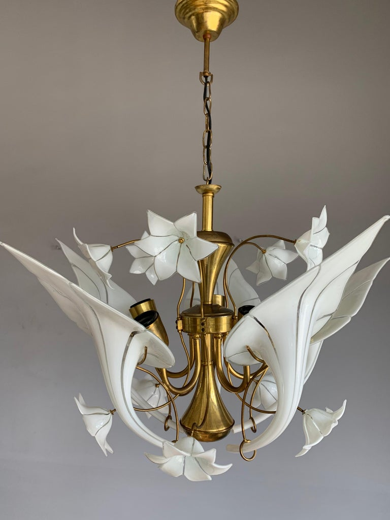 Mouth blown art glass in gilt brass frame, flower bouquet design light fixture.  If you are looking for a striking and extraordinary light fixture to grace your living space then this, Italian work of lighting art could be the one for you. This