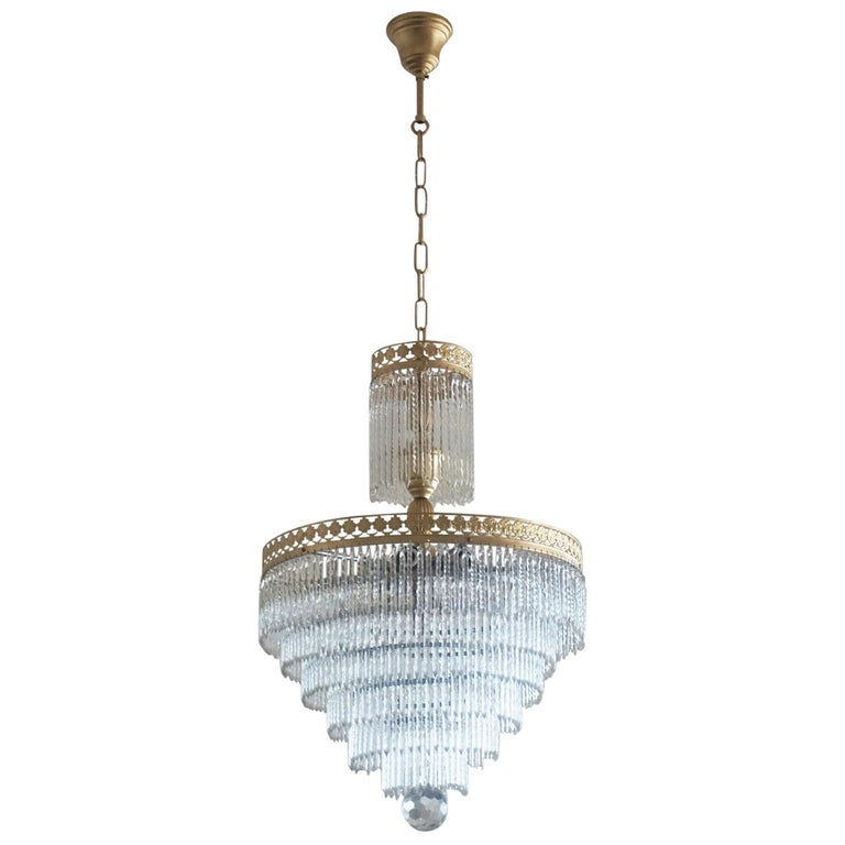 A wonderful brass and crystal waterfall chandelier with seven tiers Murano crystal sticks, Italy 1950-1959 - impressive lighting effect! This chandelier can also be used as flush mount without chain. In very good condition, rewired, all crystal