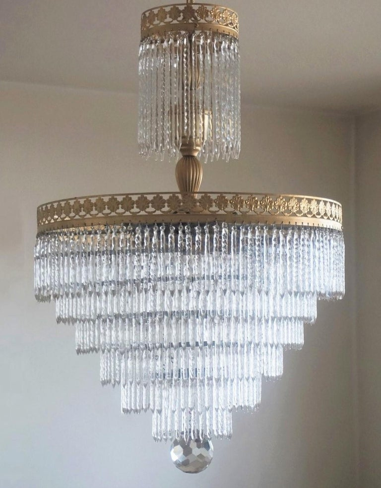 A wonderful brass and crystal waterfall flush mount or chandelier with seven tiers Murano crystal sticks, Italy 1950-1959 - impressive lighting effect!