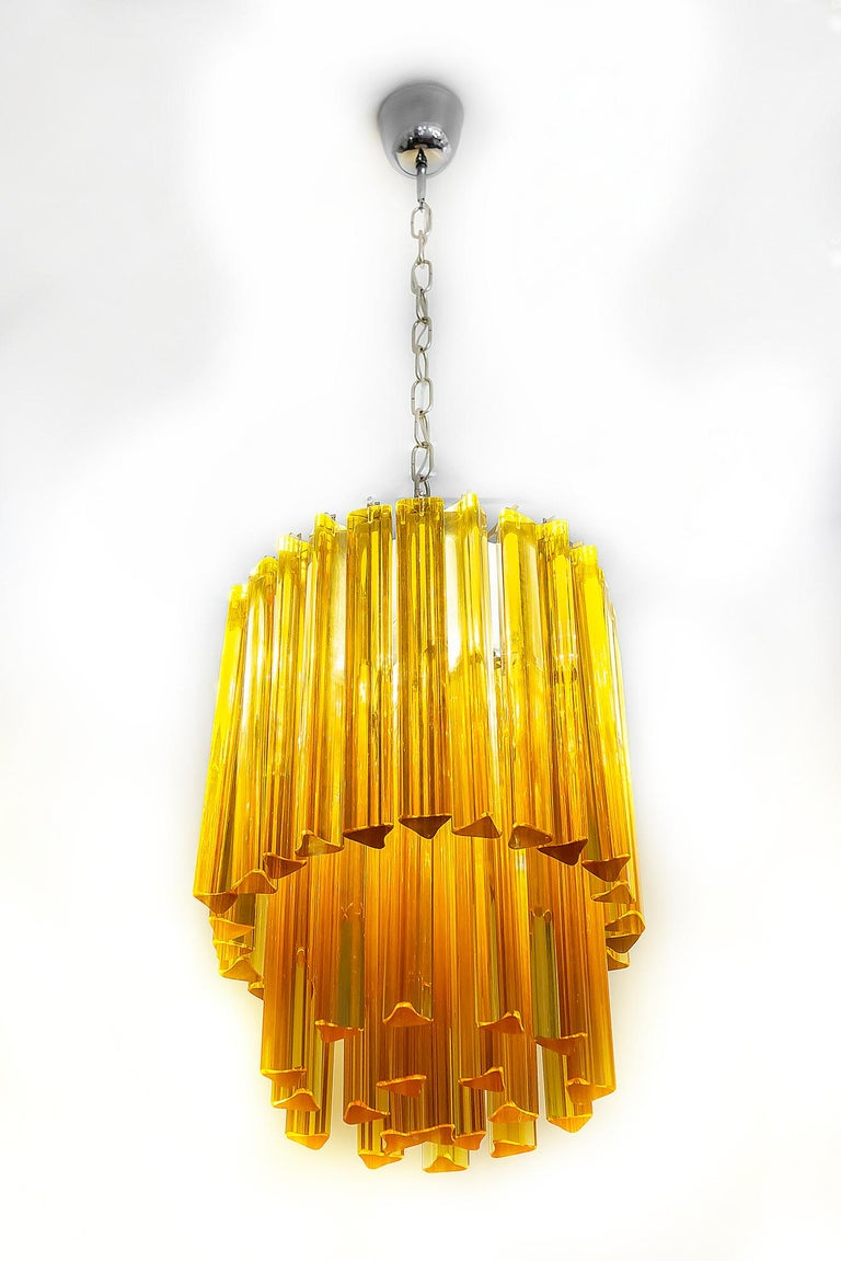 This midcentury Italian chandelier is made of solid ambra color Murano glass. It is heavy. Chandelier includes 3 pieces of E14 bulbs.