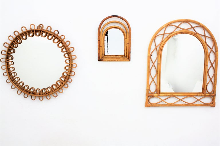 Midcentury handcrafted bamboo semioval mirror in the style of Franco Albini.  Italy, 1960s. This mirror is unusual due to its size and it has all the taste of the Mediterranean taste. It is perfect to place it alone or mixed with other cane mirrors