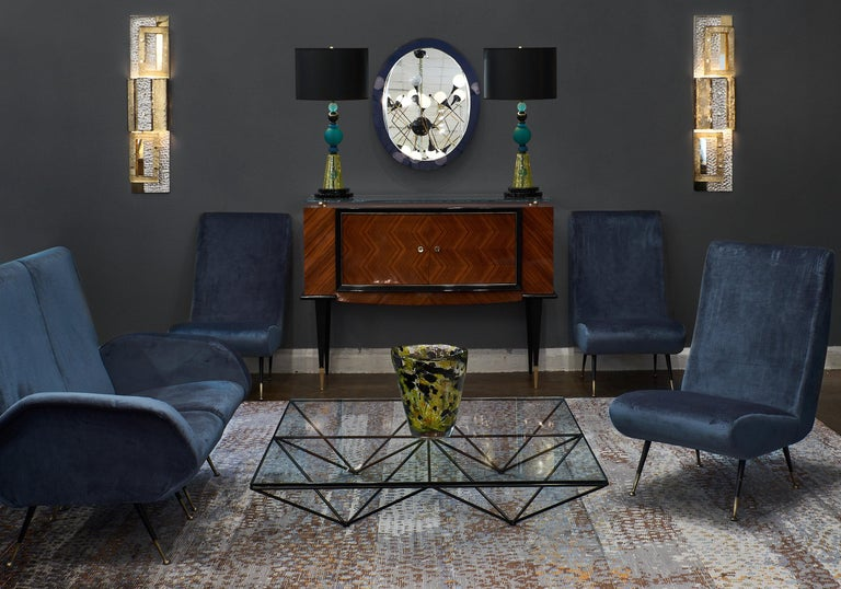 An original Italian midcentury sectional sofa group featuring five separate chairs that form a long sofa. They can be grouped as five, in smaller groups, or all separated into single entities. Great, flexible living room solution, with new blue