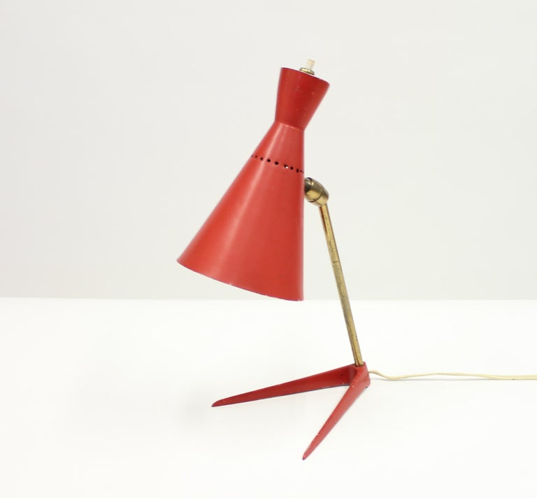 Superb 1950s Ferrari red Italian table lamp with an adjustable shade on a V-shaped base connected by a brass stem.