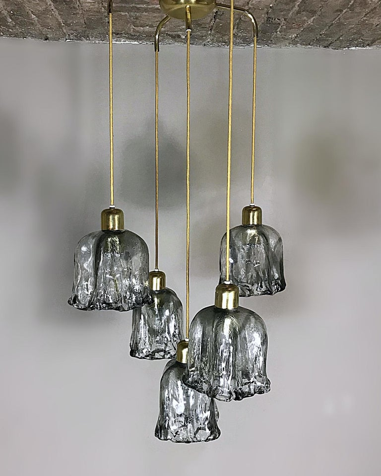 Beautiful high quality midcentury chandelier. Five heavy textured hand blown Murano glass in tulip form with brass spider. The cables can be adjusted per chandelier to alter the required height. Each glass lampshade requires an Edison E27 socket,