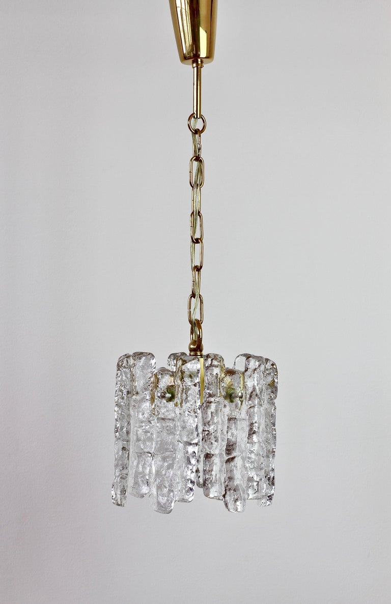 Vintage midcentury Austrian made textured clear ice glass ceiling pendant light or lamp by Kalmar, circa 1960. Featuring six hanging glass elements resembling melting ice crystals suspended from a gilt brass pendant holder. Perfect, relaxed mood
