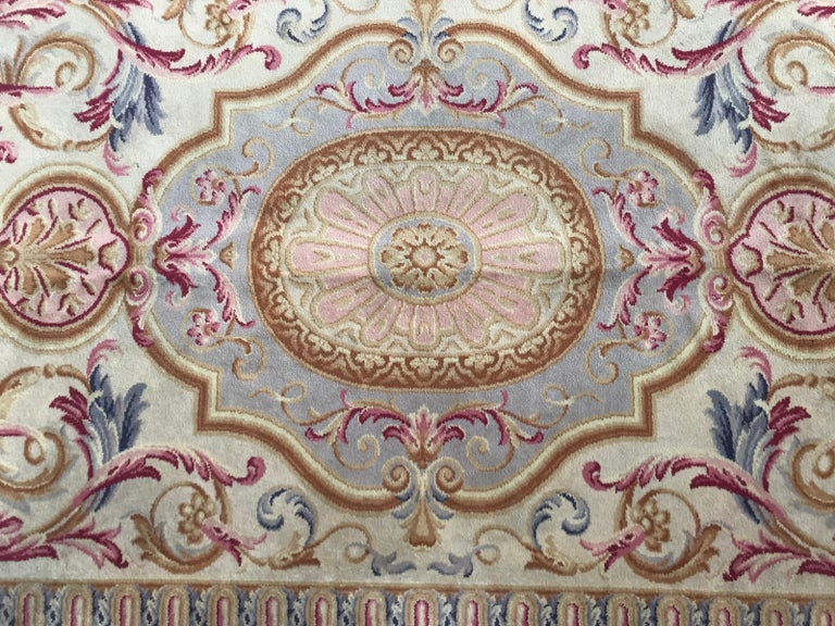 Beautiful knotted rug with a nice floral design of Louis XVI (Louis 16th) Savonnerie's, beautiful colors with pink, blue, green and brown colors. Entirely knotted with Wool velvet on cotton foundation.