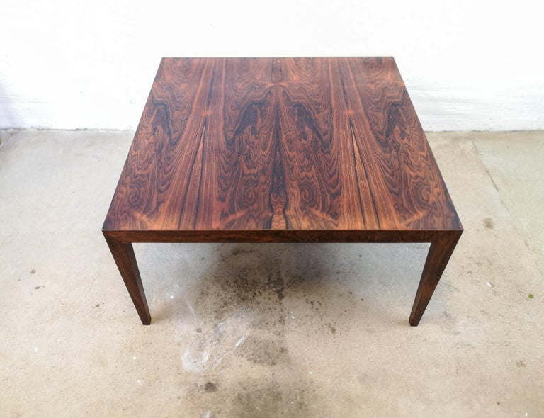 This stunning coffee table was produced in Denmark at Haslev Mobelsnedkeri. Its designed by Severin Hansen. His designed is easily recognized if you look at where the legs meet the top. Perfectly match they are and makes the table look like a piece