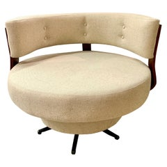 Midcentury Large Round Swivel Chair Newly Upholstered in an Oatmeal Fabric