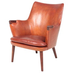 Midcentury Lounge Chair in Patinated Leather & Rosewood by Hans J. Wegner, 1950s