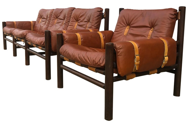 Beautiful Unique Midcentury low sling leather safari 3-seat sofa lounge chair set by Bruksbo - Norwegian Designer. The founder of Lom Møbler later Lom Møbelfabrikk, Ivar Opsvik, designed this beautiful safari-inspired chair in the 1970s. Very soft
