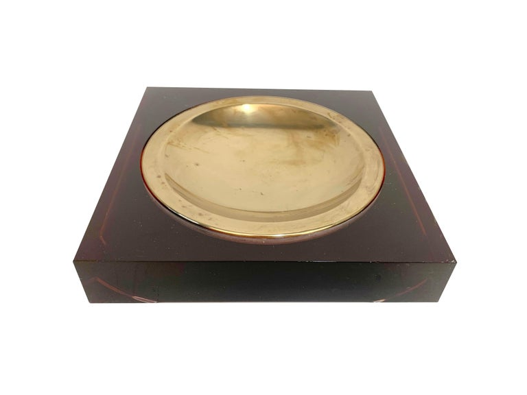Amazing midcentury Lucite and brass squared valet tray. This wonderful item was produced in France in the style of Christian Dior in 1970.