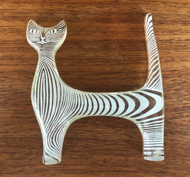 Midcentury Lucite cat sculpture by Brazilian artist Abraham Palatnik, circa 1960s. Palatnik was a Pioneer in the Kinetic and Op Art movements. This piece of a cat with her enigmatic smile is striped in white throughout and is signed