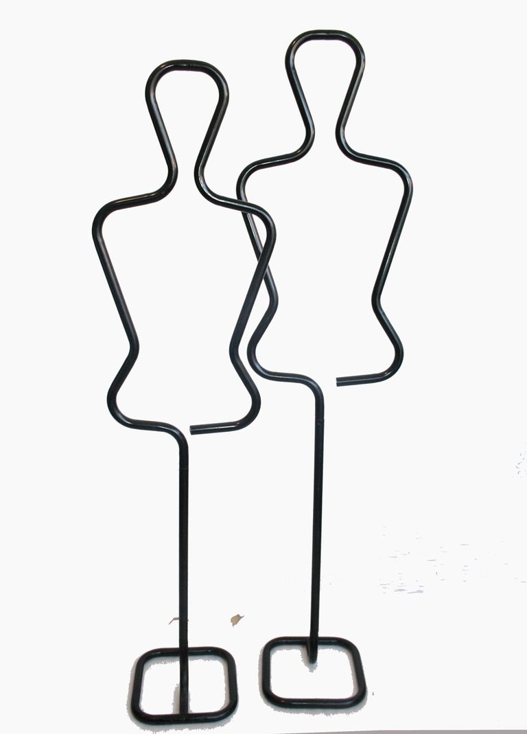 Midcentury Italian sculptural male valet or coatrack. Black tubular metal.. Excellent vintage condition.  Detachable for shipping