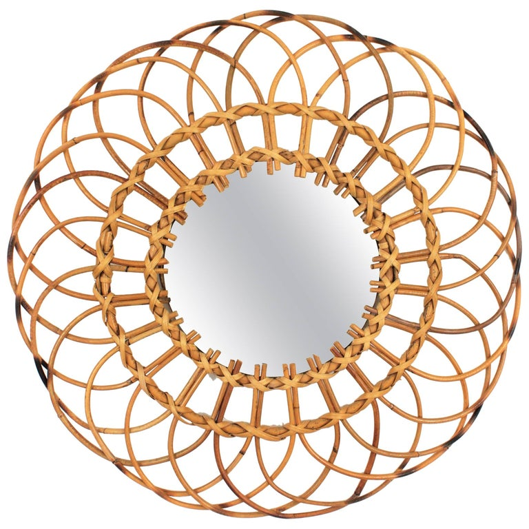 Beautiful Mid-Century Modern Mediterran Wicker and rattan flower burst or sunburst mirror. Spain, 1960s. This mirror was handcrafted in Spain at the sixties. It has all the freshness of the Mediterranean taste and it will be a nice addition in a