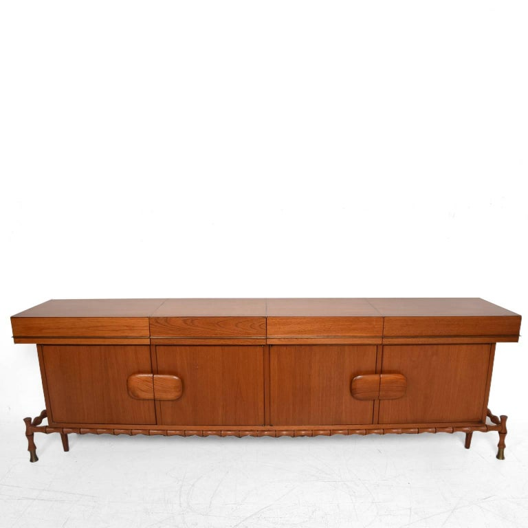 """For your consideration a beautiful floating credenza. (Beautiful faux bamboo details). Made of Mexican Mahogany and brass. circa 1960s. by Frank Kyle. Unmarked no signature from the maker. Dimensions: 35"""" H x 106"""" W x 20"""" D."""