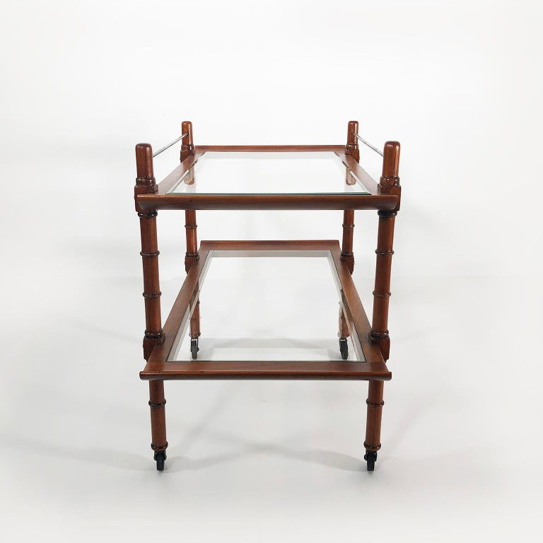 Rare rolling bar or serving cart made of mahogany and steel, designed by Frank Kyle, circa 1950.