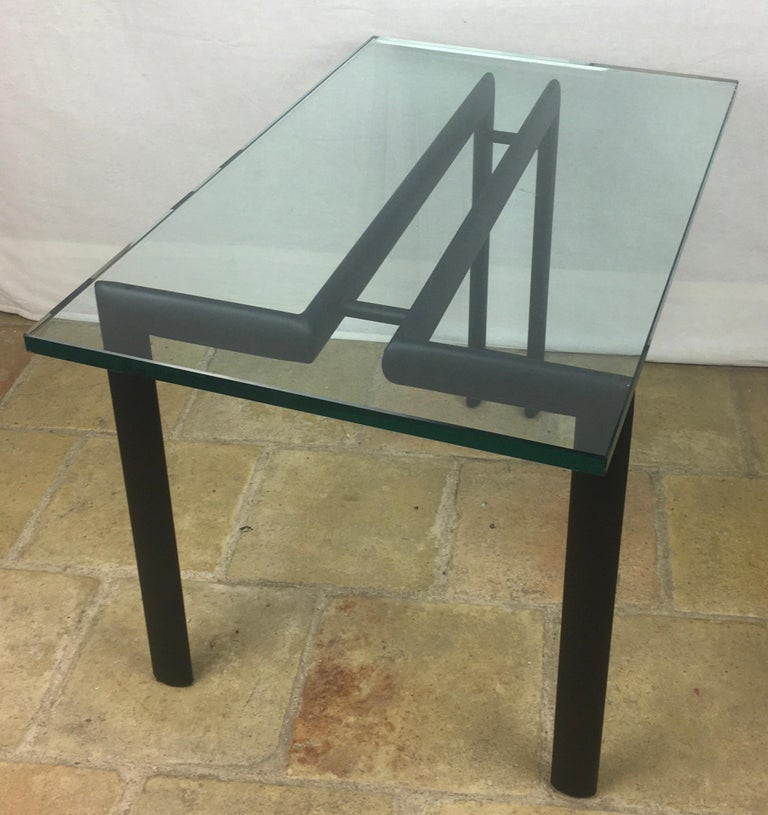 A simple metal and glass end or side table. The glass top simply floats on the base.  Measures: 12 1/4