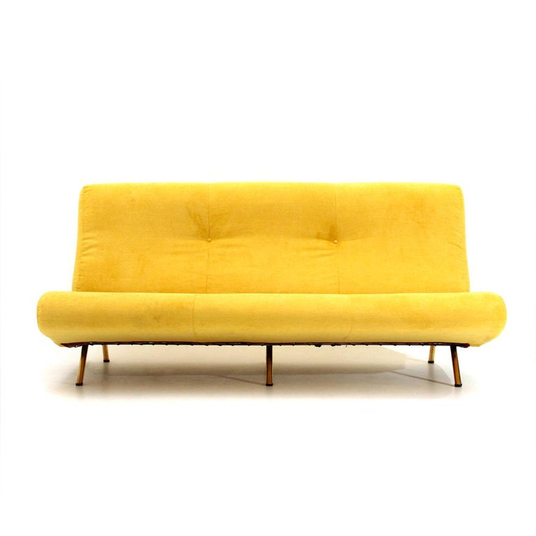 Sofa produced in the 1950s by Arflex based on a design by Marco Zanuso. Metal structure padded and lined with new yellow velvet fabric. Backrest stitched with two buttons. Metal legs covered in brass. Good general condition, some signs due to