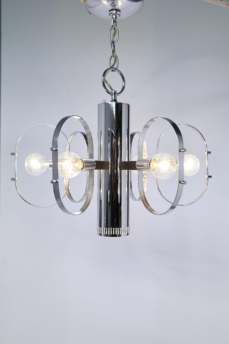 Great quality midcentury light fixture by Forecast Lighting having a tubular pendant with hidden downward facing light and six lights around the perimeter framed by metal orbs. The fixture is on a three way switch so that you can turn on the bottom