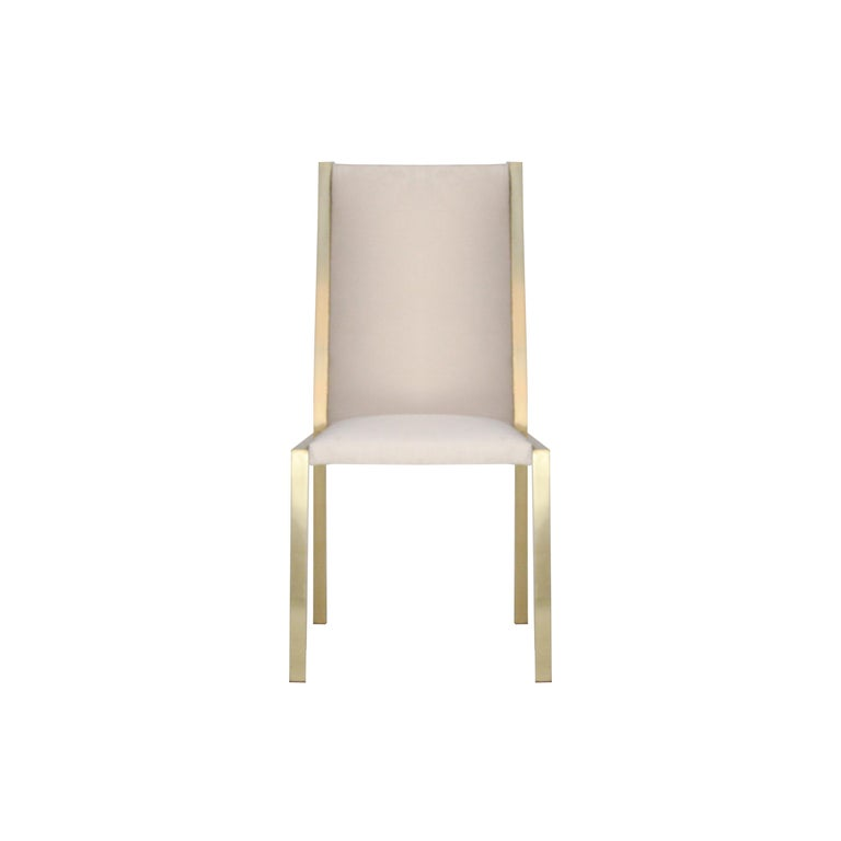 Set of eight chairs with brass structure. Seat and backrest upholstered in cotton velvet.