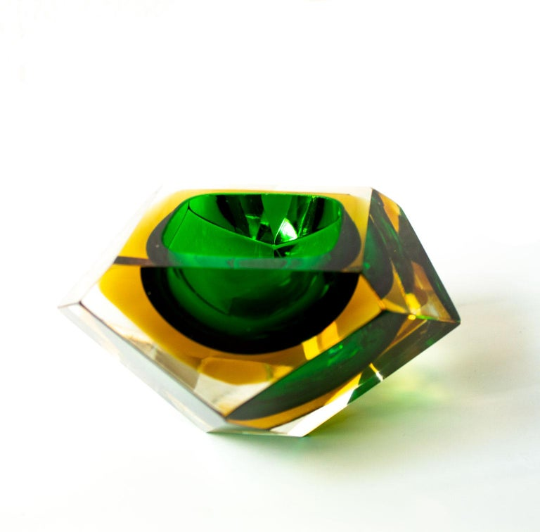 Italian Mid-Century Modern green and yellow Sommerso Murano glass bowl attributed to Flavio Poli.  Designed in a diamond shaped 12 faceted sides in hues of yellow and green. Cool deco item that can be used as a serve ware, ashtray or jewelry bowl.