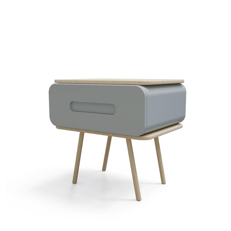 Bring a Minimalist style to your living room with this unique nightstand. Seti nightstand showcase a rectangular metal clean-lined silhouette on four round legs featuring a contrasting finish.