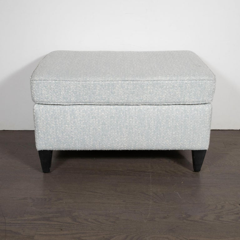 """This refined and understated ottoman were designed by Paul McCobb- one of the most celebrated and influential figures in 20th century design- in America, circa 1950. The ottoman offers conical legs in ebonized walnut. McCobb once opined: """"Design"""